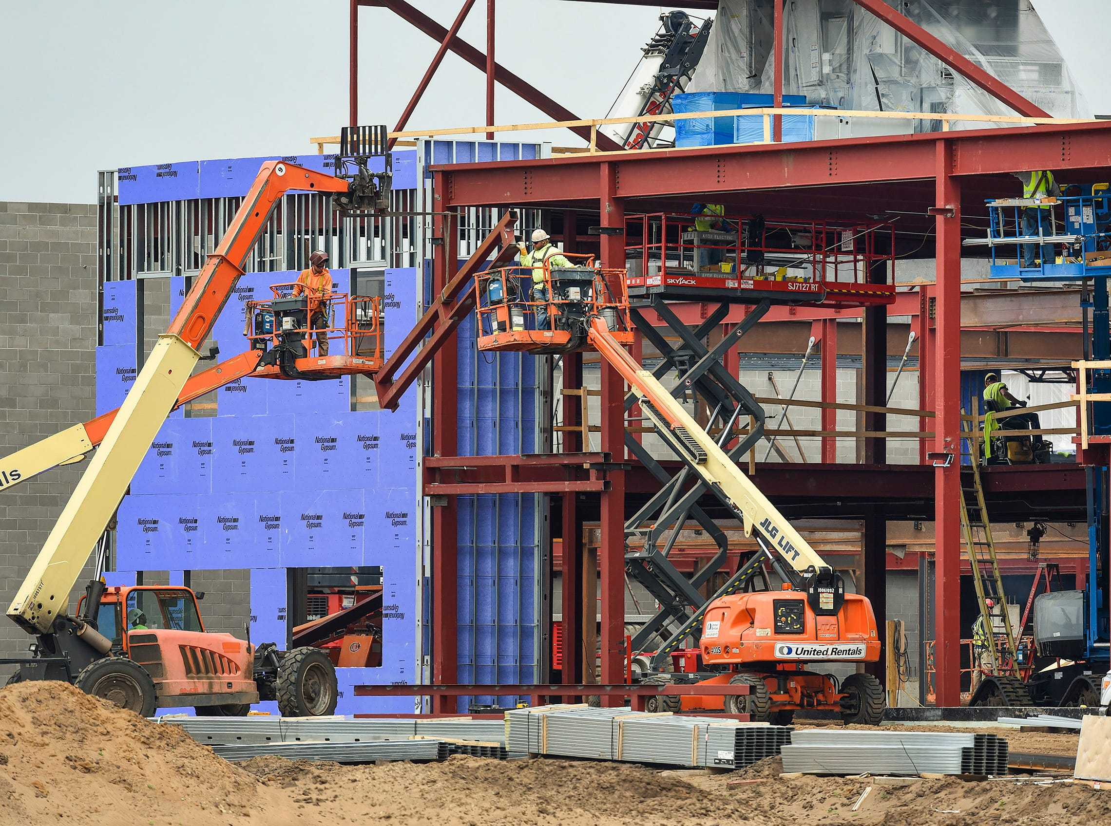 Construction continues on the structural steel on the new Sartell High School Tuesday, May 22, in Sartell.