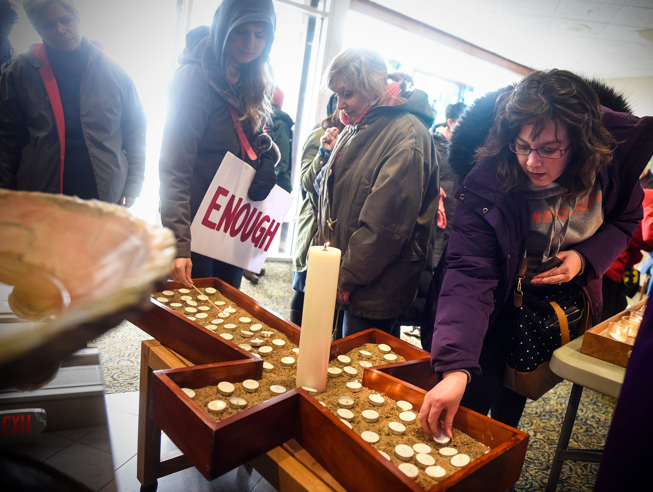 Participants light candles in memory of shooting victims during a  March For Our Lives event  at First United Methodist church Saturday, March 24, in Sartell.