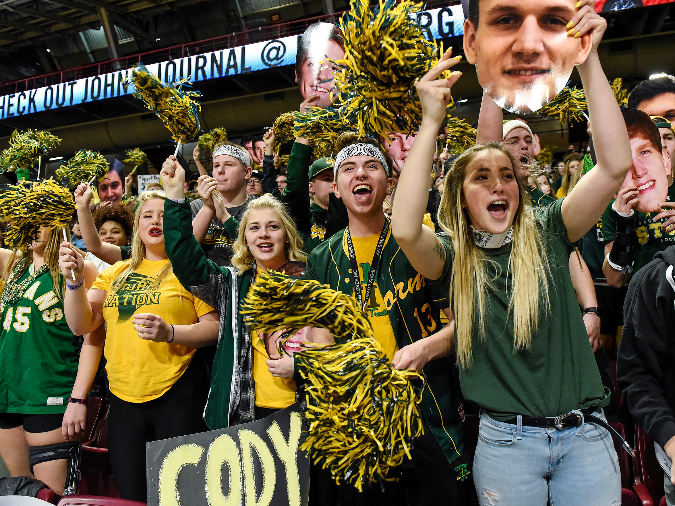 Sauk Rapids fans cheer for their team against Austin Wednesday, March 21, in the first round of the state Class 3A boys basketball tournament at Williams Arena in Minneapolis.