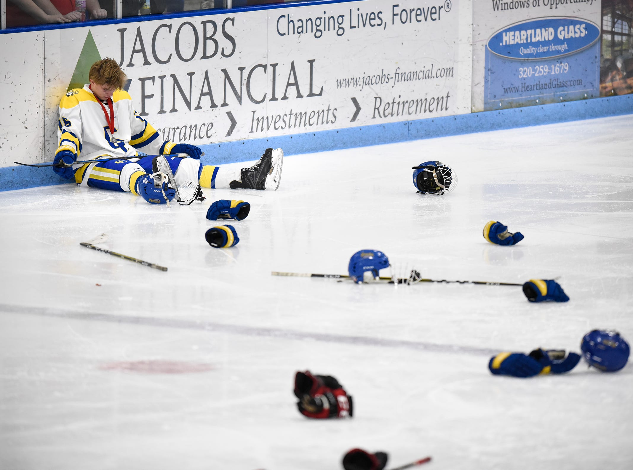 Cathedral's Matthew Wedin sits by himself during the awards ceremony following the Section 6A hockey finals at the MAC in St. Cloud. Cathedral lost 3-2 to Alexandria in two overtimes.