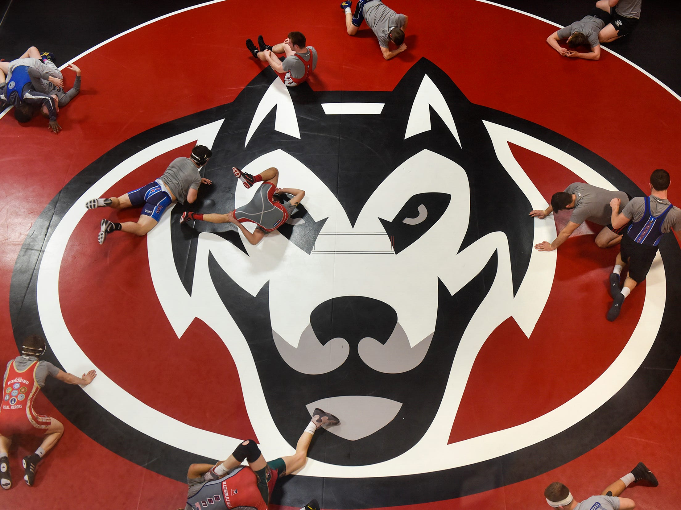 St. Cloud State wrestling team members practice on new mats in the team's practice room Saturday, Feb. 10, at Halenbeck Hall. The team raised more than $20,000 through Crowdsource funding  to help pay for the new mats.
