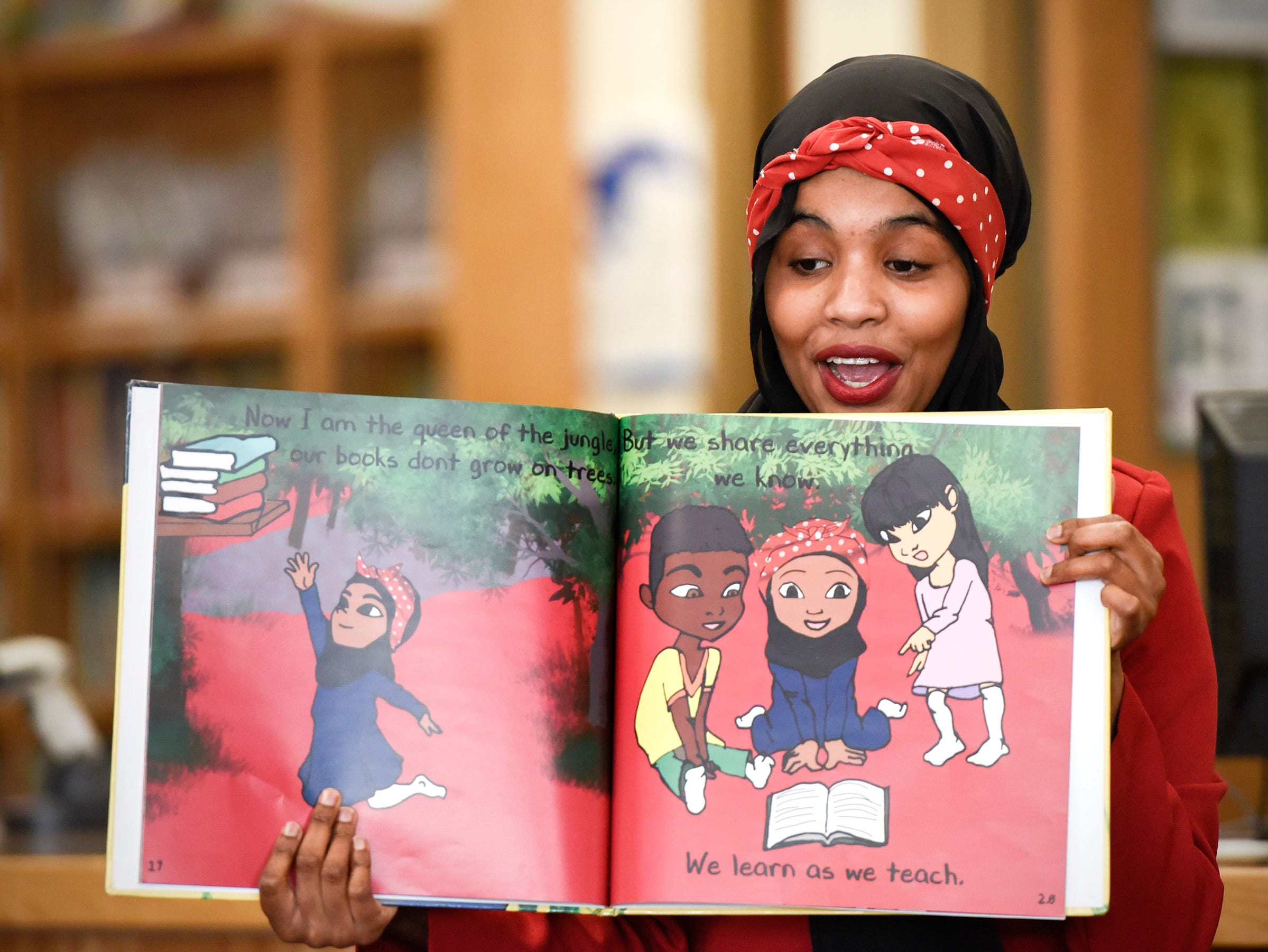 "Habso Mohamud, a St. Cloud School District and St. Cloud State University graduate, reads her book called ""It Only Takes One Yes"" Wednesday, Nov. 7, to students at Madison Elementary School."