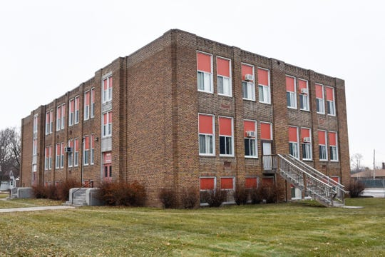 The Wilson school building shown Wednesday, Dec. 19, is now vacant, and the school board has to decide what to do with it.
