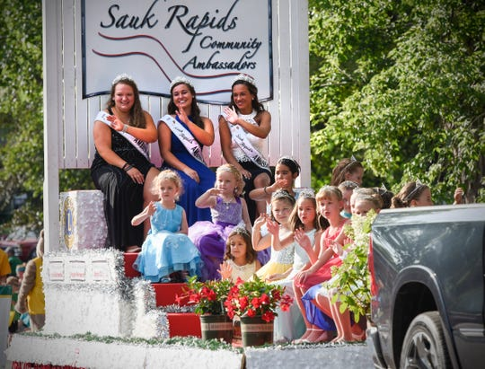 The 2018 Sauk Rapids Community Ambassadors wave to the crowd during the Sauk Rapids River Days parade June 22, 2018 in Sauk Rapids.