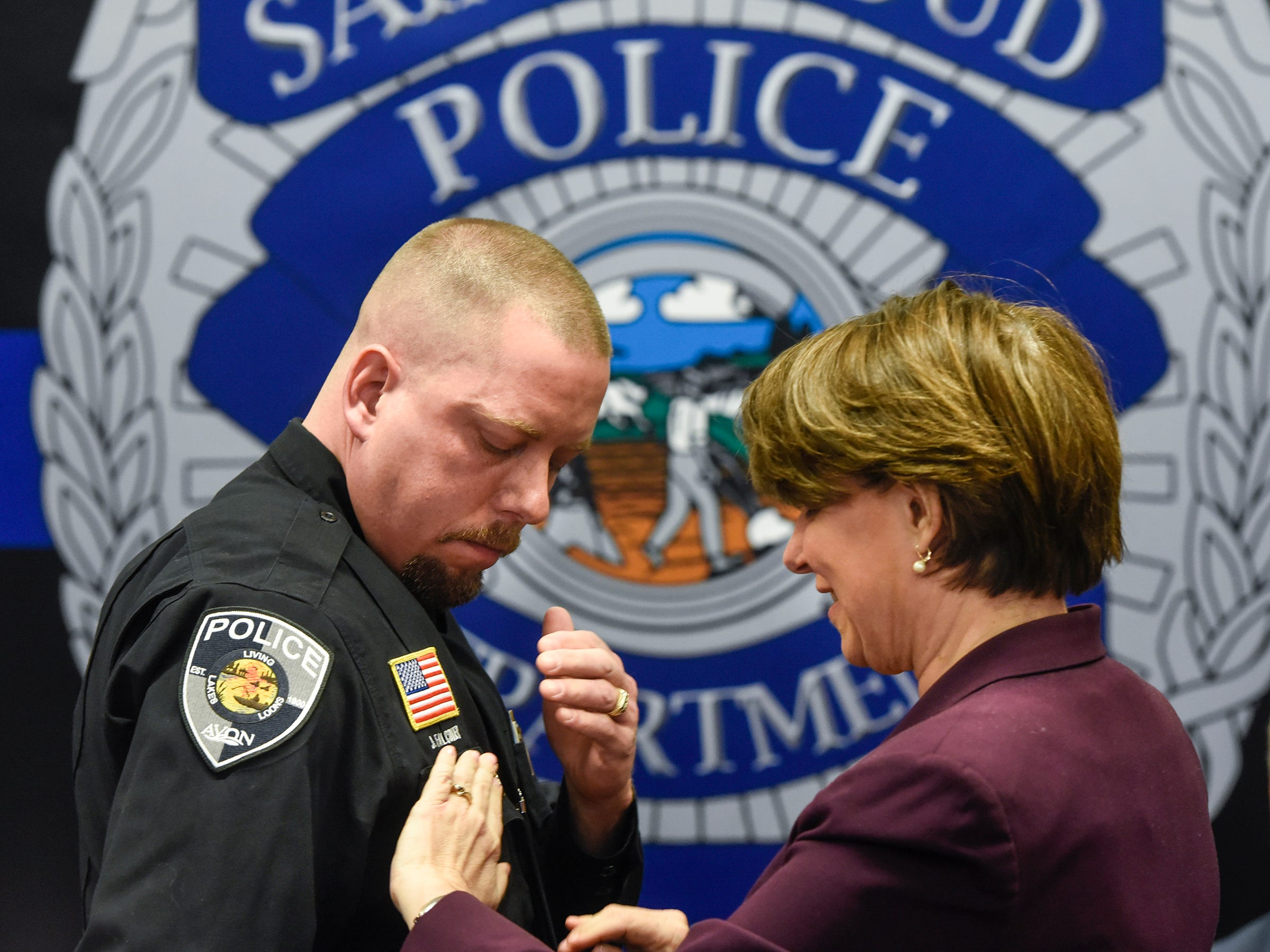 U.S. Sen. Amy Klobuchar takes part in a ceremony awarding officer Jason Falconer with the Congressional Badge of Bravery Award Thursday, April 5, at the St. Cloud Police Department in St. Cloud.
