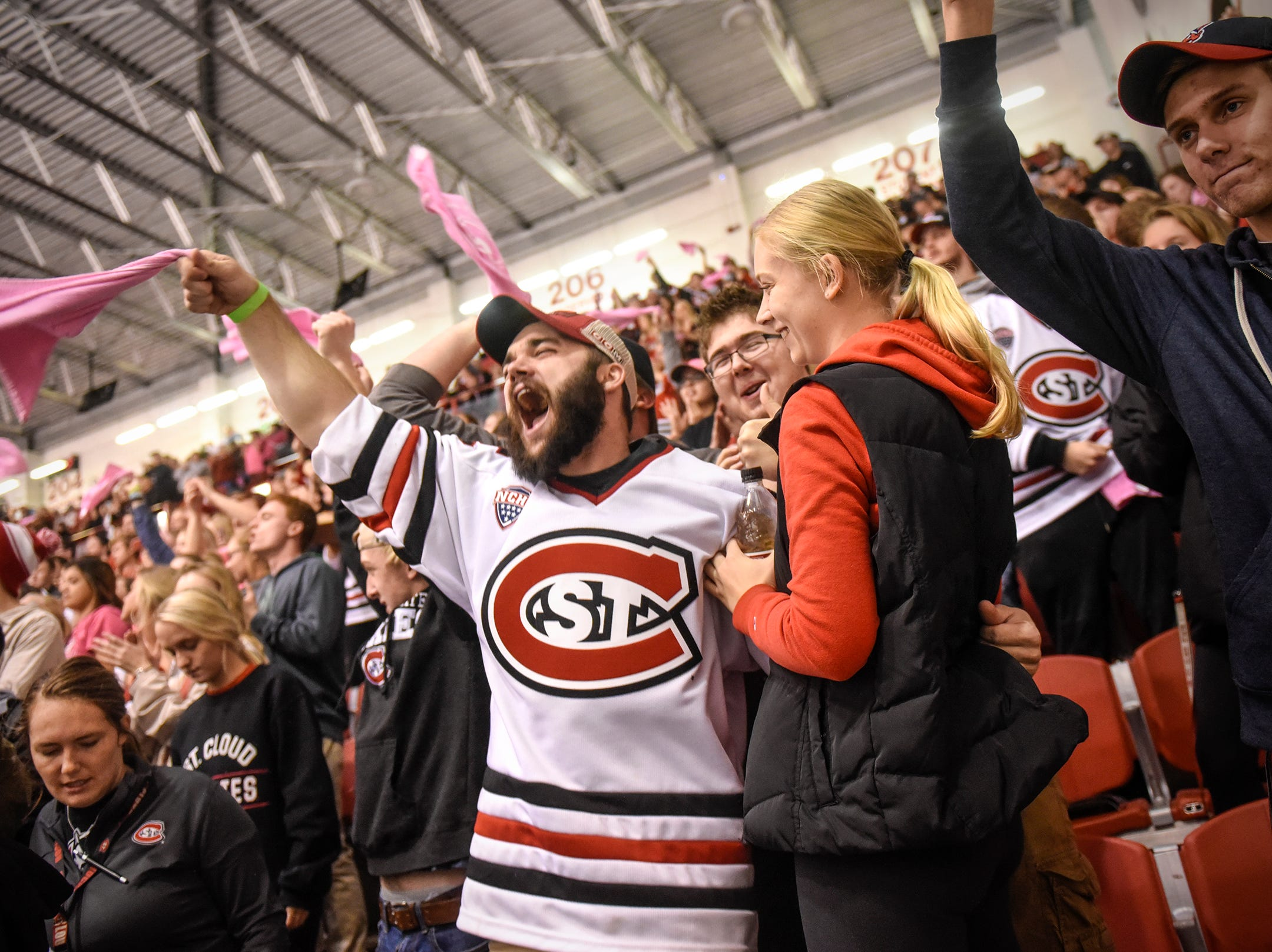 St. Cloud State fans celebrate a goal during the first period of the Friday, Oct. 19, game against Northern Michigan at the Herb Brooks National Hockey Center in St. Cloud.