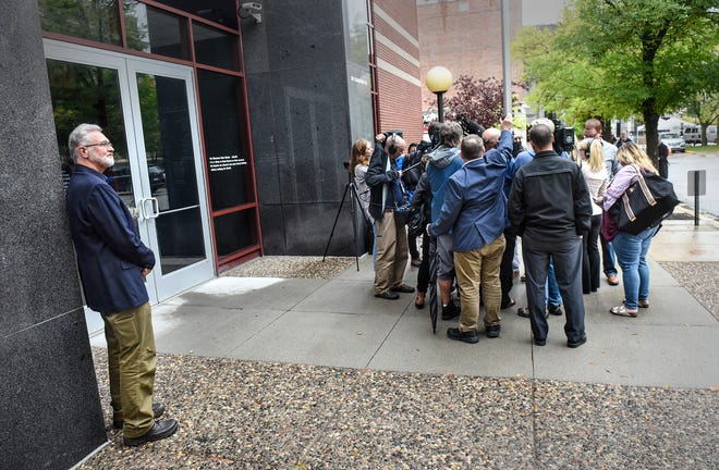 Jerry Wetterling stands alone as reporters circle around former FBI agent Al Garber following a press conference for the release of investigative files in the case of his son Jacob Thursday, Sept. 20, 2018, in St. Cloud.