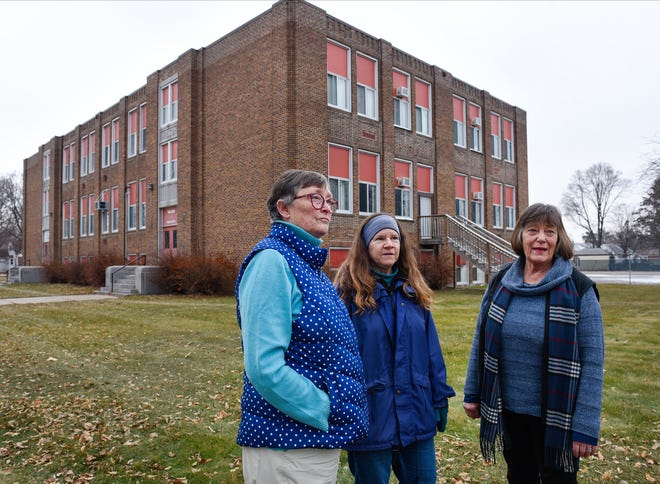 Glenda Burgeson, Kaye Schimnich and Jane Brown talk Wednesday, Dec. 19, about what they would like to happen to the Wilson school building, which is located in their neighborhood.