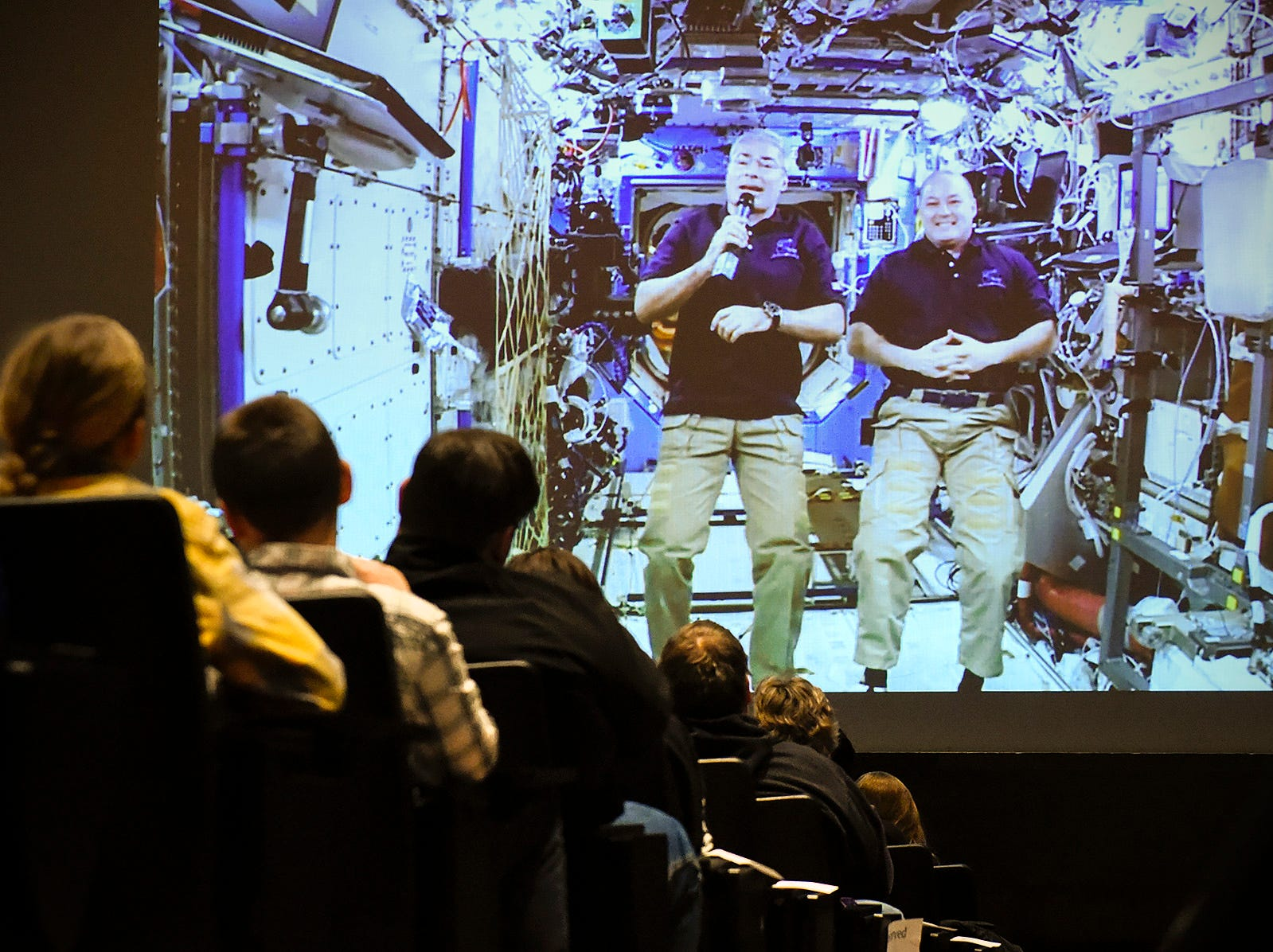 NASA astronauts Mark Vande Hei and Scott Tingle answer students questions from the International Space Station Tuesday, Feb. 20, at the Pellegrene Auditorium at St. John's University.