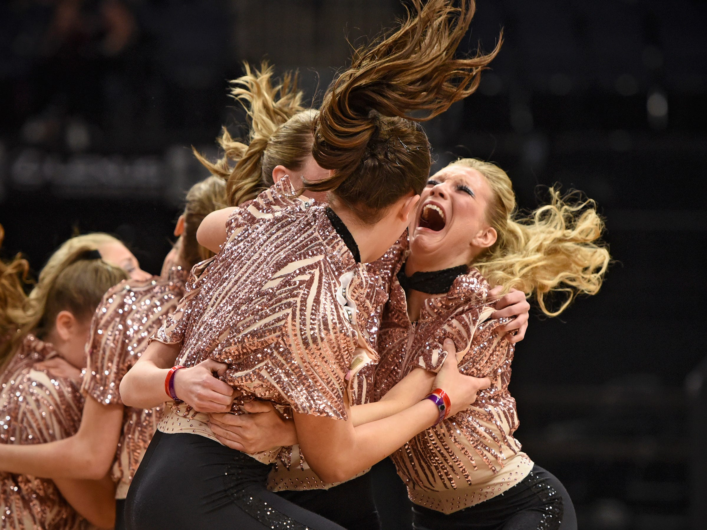 Sartell Dance Team members react at the announcement of their first place finish during Minnesota State Dance Team High Kick competition Saturday, Feb. 17, at the Target Center in Minneapolis.