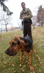 K9 handler Zach Milne works with new Stearns County K9 Storm Wednesday, Dec. 19, in St. Cloud.