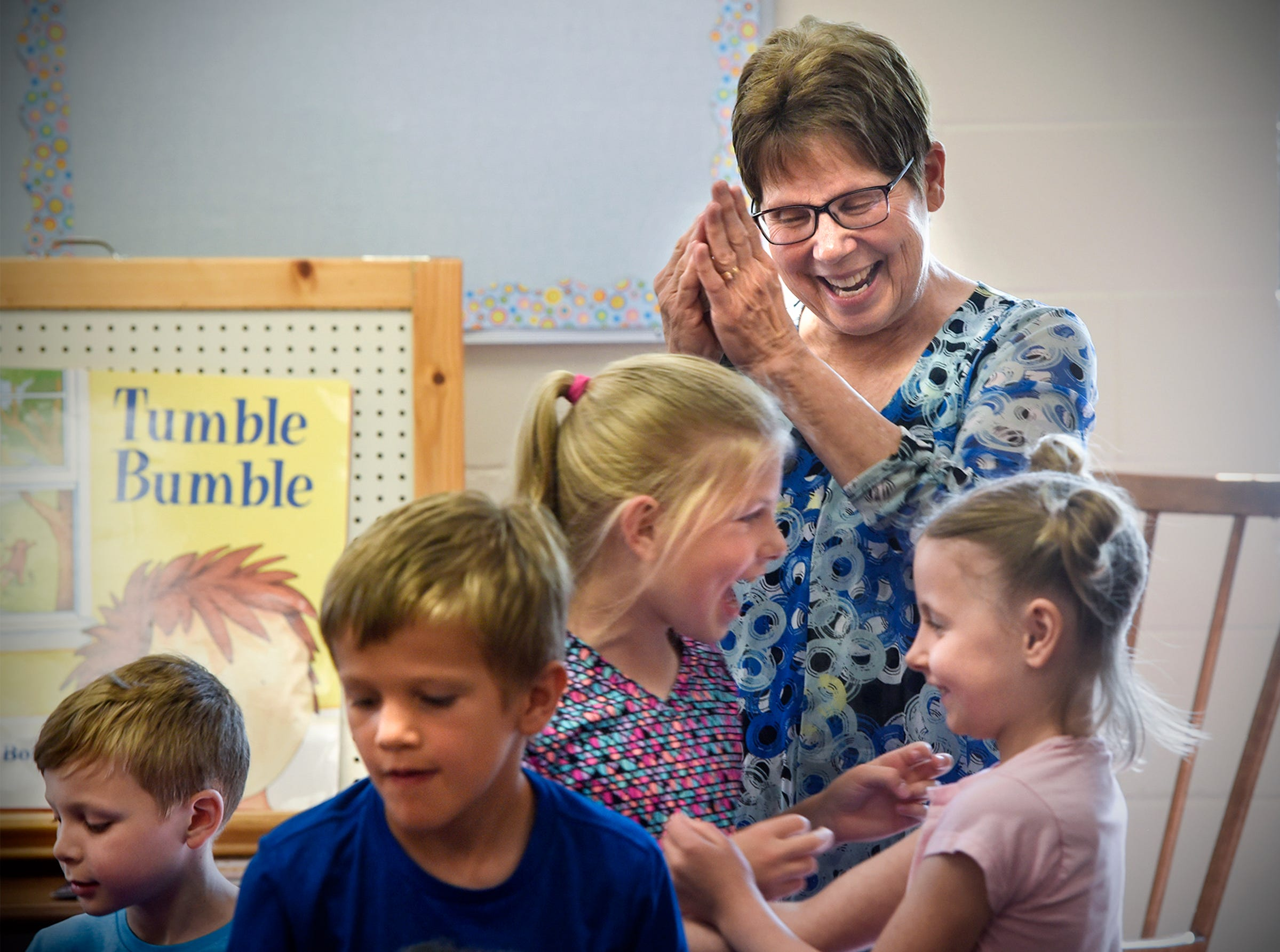 St. Boniface School first-grade teacher Carol Sell smiles while leading students through a game during her last day of class Thursday, May 31, in Cold Spring. Sell has been a teacher at St. Boniface for 45 years.