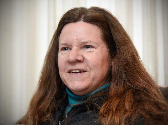 Kaye Schimnich talks about the Wilson School building Wednesday, Dec. 19, that is located in her neighborhood.