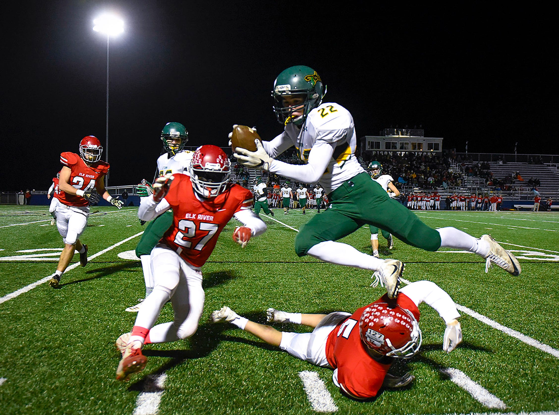 Sauk Rapids wide receiver Christian Rodriguez if forced out of bounds by Elk River during the first half Friday, Nov. 2, in the Section 6-5A championship at Buffalo High School.