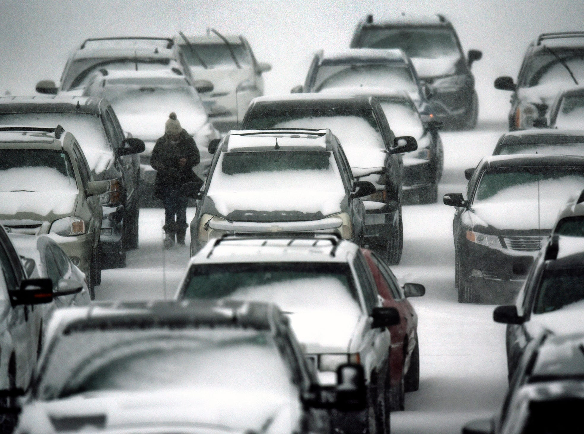 Heavy snow falls on cars parked in the lot at the MAC Saturday afternoon, Feb. 24, in St. Cloud.