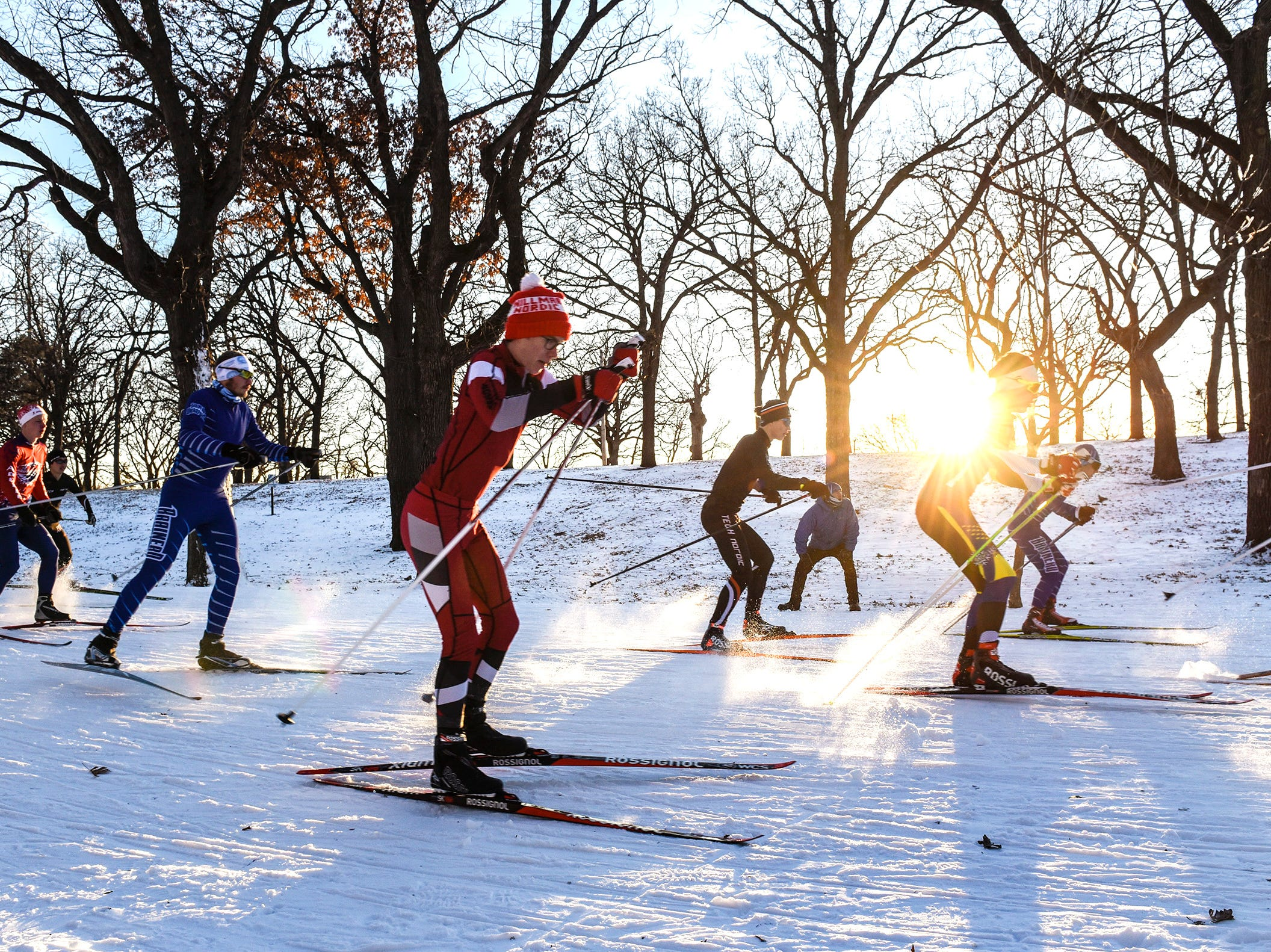 Boys varsity skiers navigate the course Thursday, Dec. 6, during the Central Lakes Conference Nordic Skiing Invitational at Riverside Park in St. Cloud.