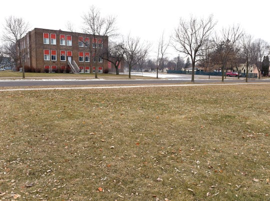 The Wilson school building and a vacant lot next to it are shown Wednesday, Dec. 19. The school is now vacant and the school board has to decide what to do with the building and lot.