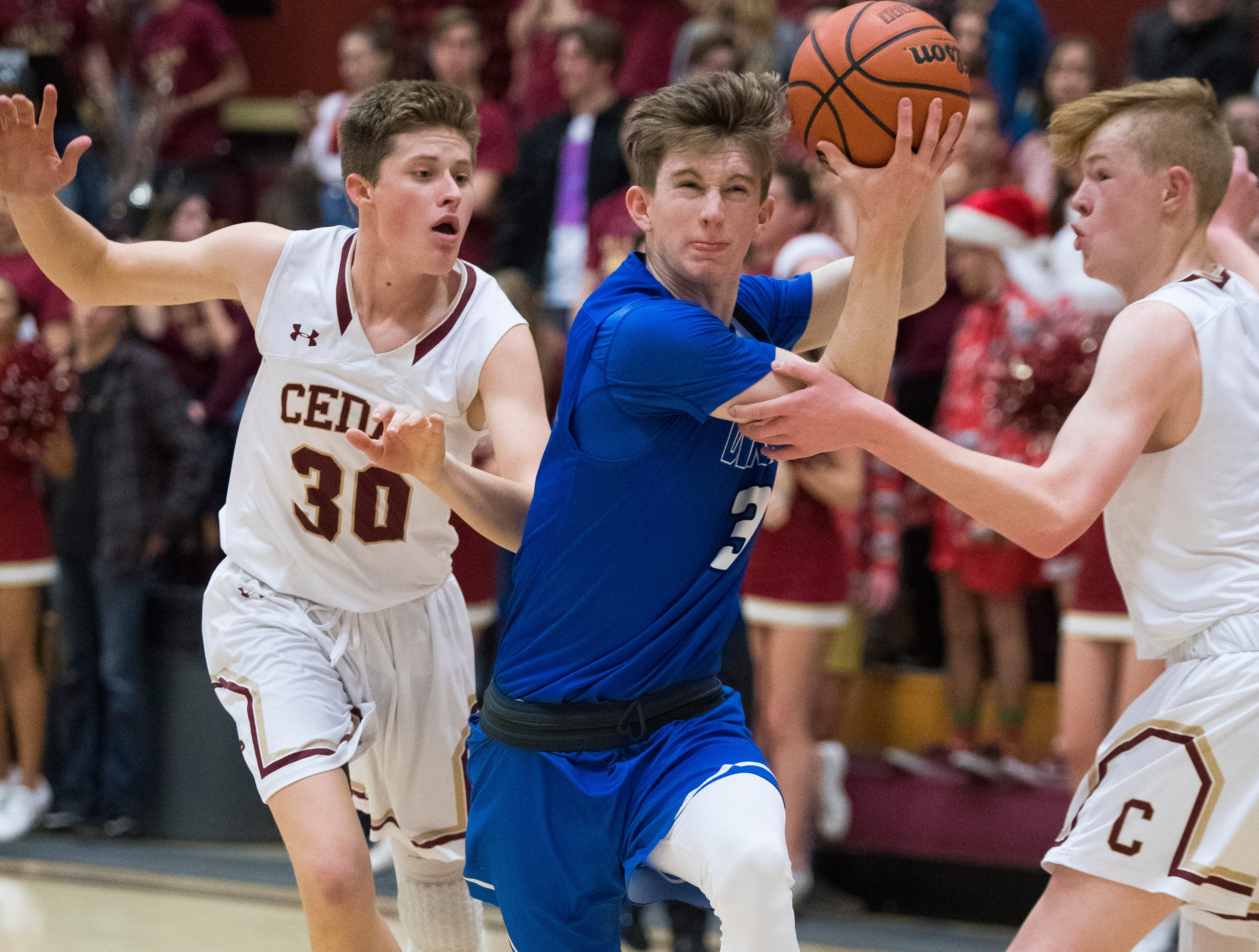 Dixie High School senior Nicholas Roundy (3) pushes toward the Cedar basket at CHS Wednesday, December 19, 2018. Trading the lead all game, Dixie won, 49-45.