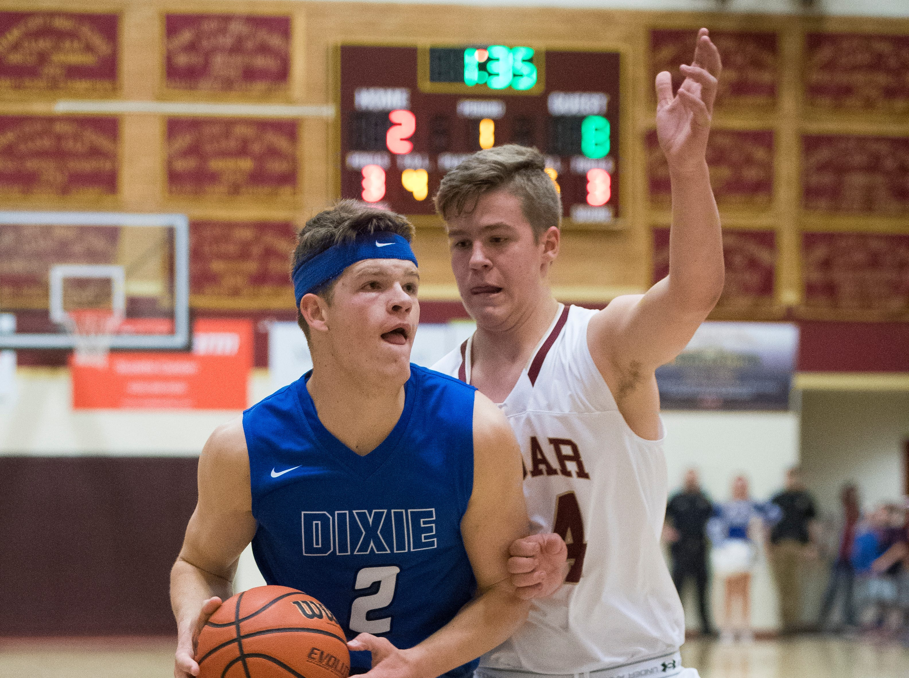 Dixie High School senior Justin Weidauer (2) pushes into the key against Cedar at CHS Wednesday, December 19, 2018. Trading the lead all game, Dixie won, 49-45.