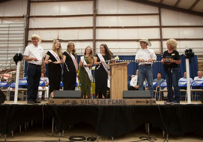 The Washington County Fair royalty, County Commissioners and Fair Director Wendy Sandberg open the fair with a ribbon cutting Wednesday, August 8, 2018.