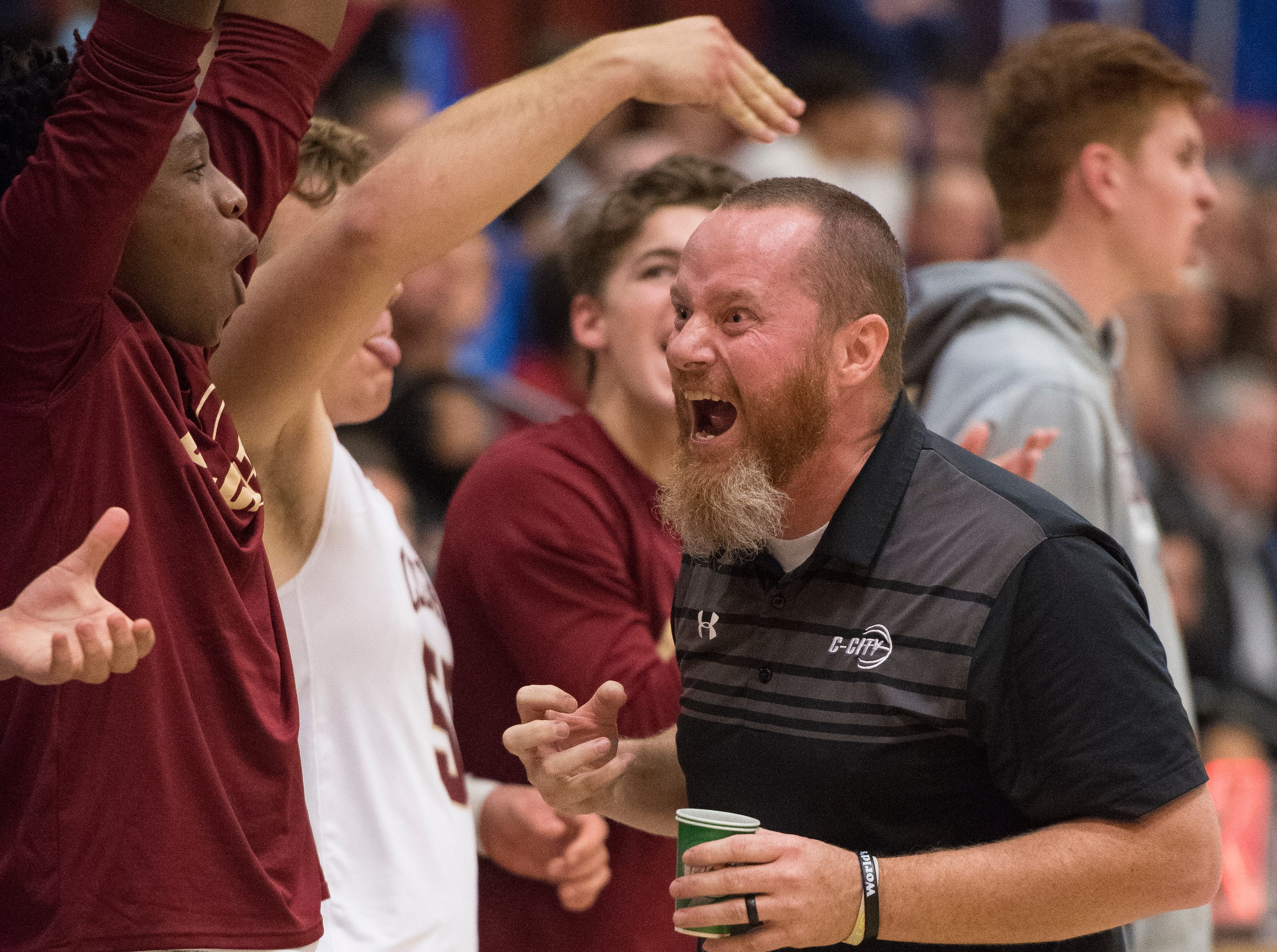 Cedar High School head coach Russ Beck celebrates a score against Dixie at CHS Wednesday, December 19, 2018. Trading the lead all game, Dixie won, 49-45.
