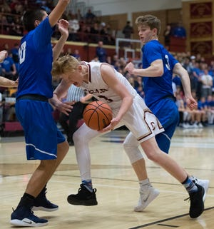 Cedar High School sophomore Gaige Savage (3) tries to force his way into the key against Dixie at CHS Wednesday, December 19, 2018. Trading the lead all game, Dixie won, 49-45.