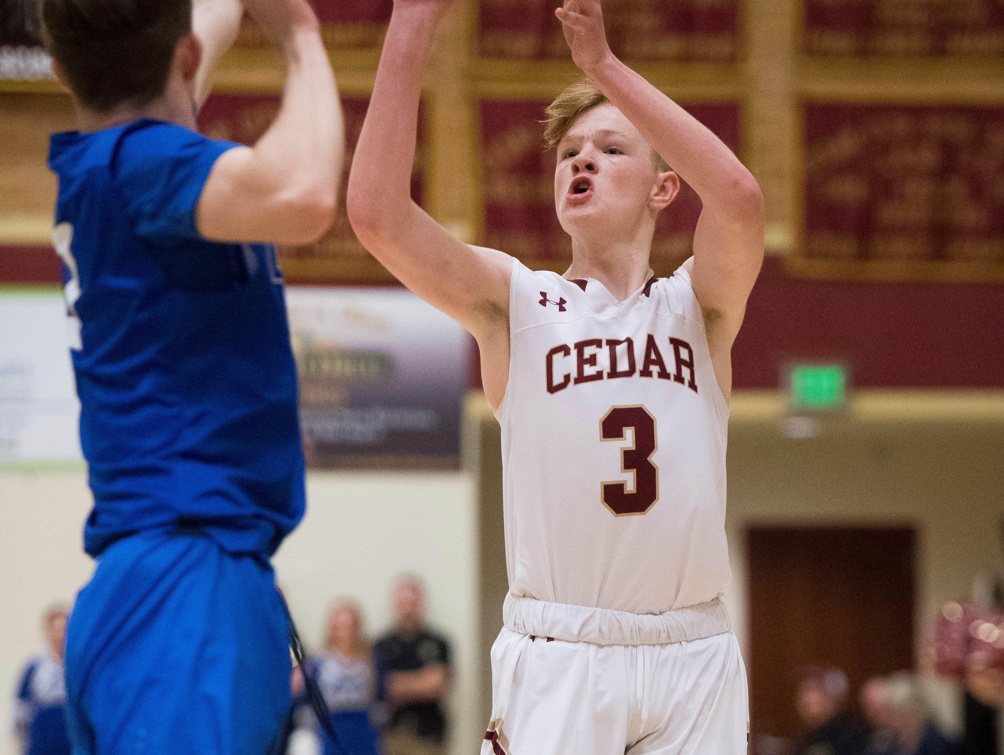 Cedar High School sophomore Gaige Savage (3) takes a shot against Dixie at CHS Wednesday, December 19, 2018. Trading the lead all game, Dixie won, 49-45.