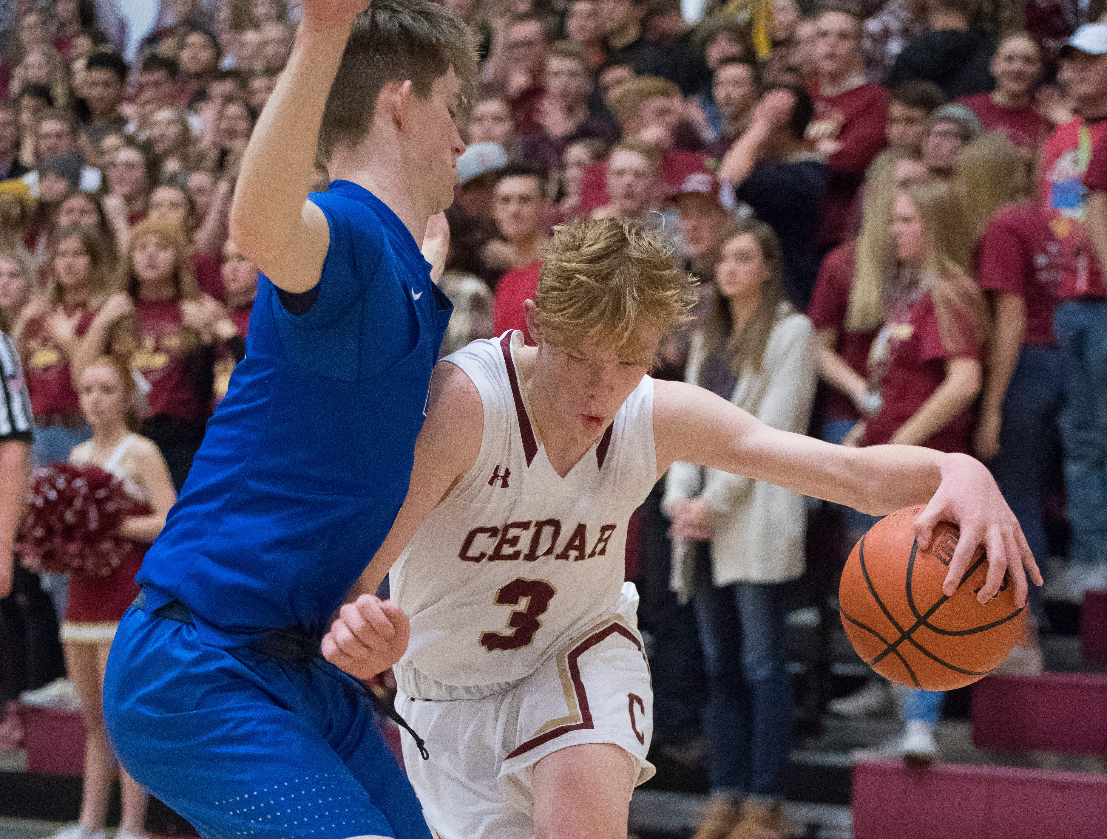 Cedar High School sophomore Gaige Savage (3) pushes along the base line against Dixie at CHS Wednesday, December 19, 2018. Trading the lead all game, Dixie won, 49-45.