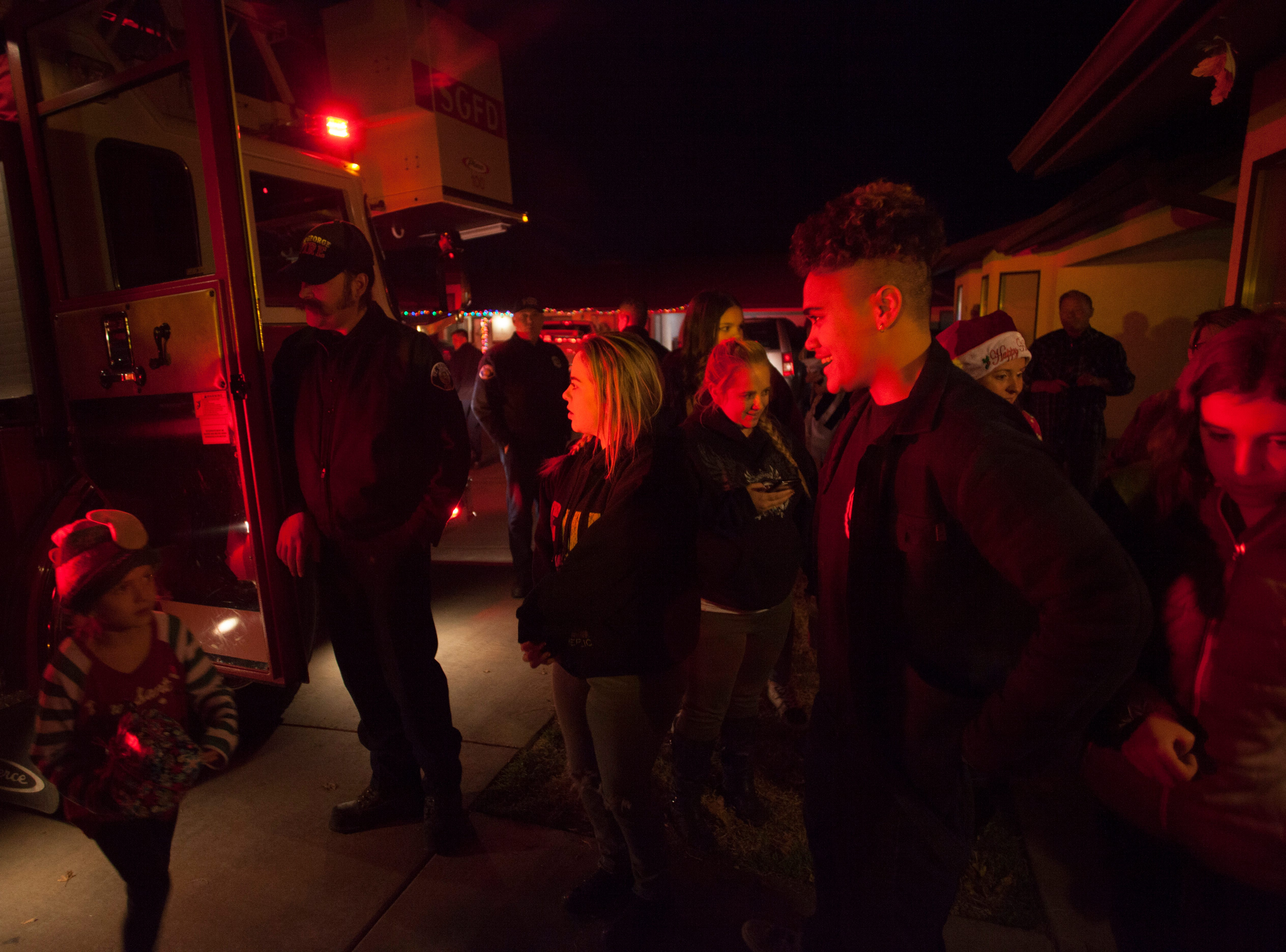 Members of the St. George Fire Department and community volunteers deliver gifts as part of the Angel Tree Project Monday, Dec. 17, 2018.