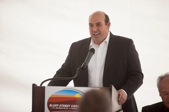 Walt Brooks, form the Utah State Legislature, speaks during the ribbon cutting ceremony for the Bluff Street Corridor Wednesday, Dec. 19, 2018.