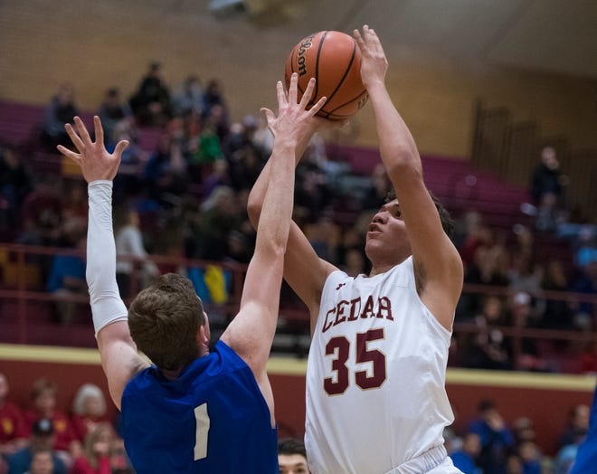 Cedar High School senior Zab Santana (35) is one of three Redmen averaging over 10 points per game. Santana and the Redmen will be one of six teams facing off in the first full week of Region 9 play this Friday night.