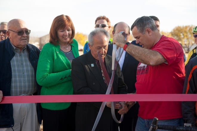 Utah Transportation Commissioner Naghi Zeenati and St. George Mayor Jon Pike wield ceremonial scissors at the ribbon cutting marking the completion of the Bluff Street construction project Wednesday, Dec. 19, 2018.