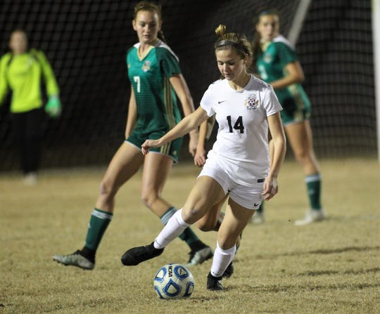 Leon senior Emma McGibany dribbles back out of the box to look for a pass during a game against Lincoln this past week. McGibany scored two goals in the Lions' 2-1 win.