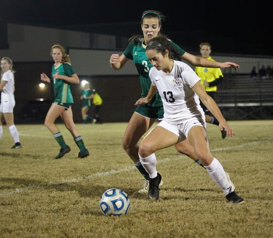 Leon's Liney Brantley works to get past Lincoln's Kailey Williams as Leon beat Lincoln 2-1 on Monday, Dec. 17, 2018.