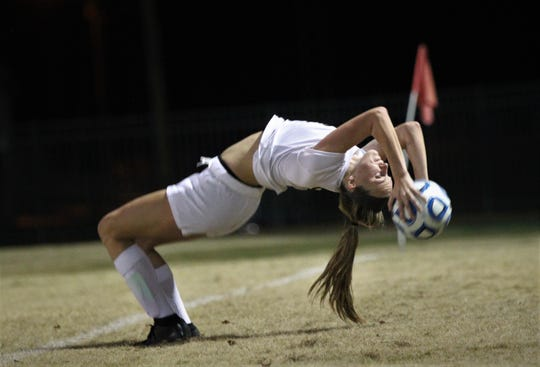 Leon's Madison Rumenik performs a flip throw-in as the Lions beat Lincoln 2-1 on Monday, Dec. 17, 2018.