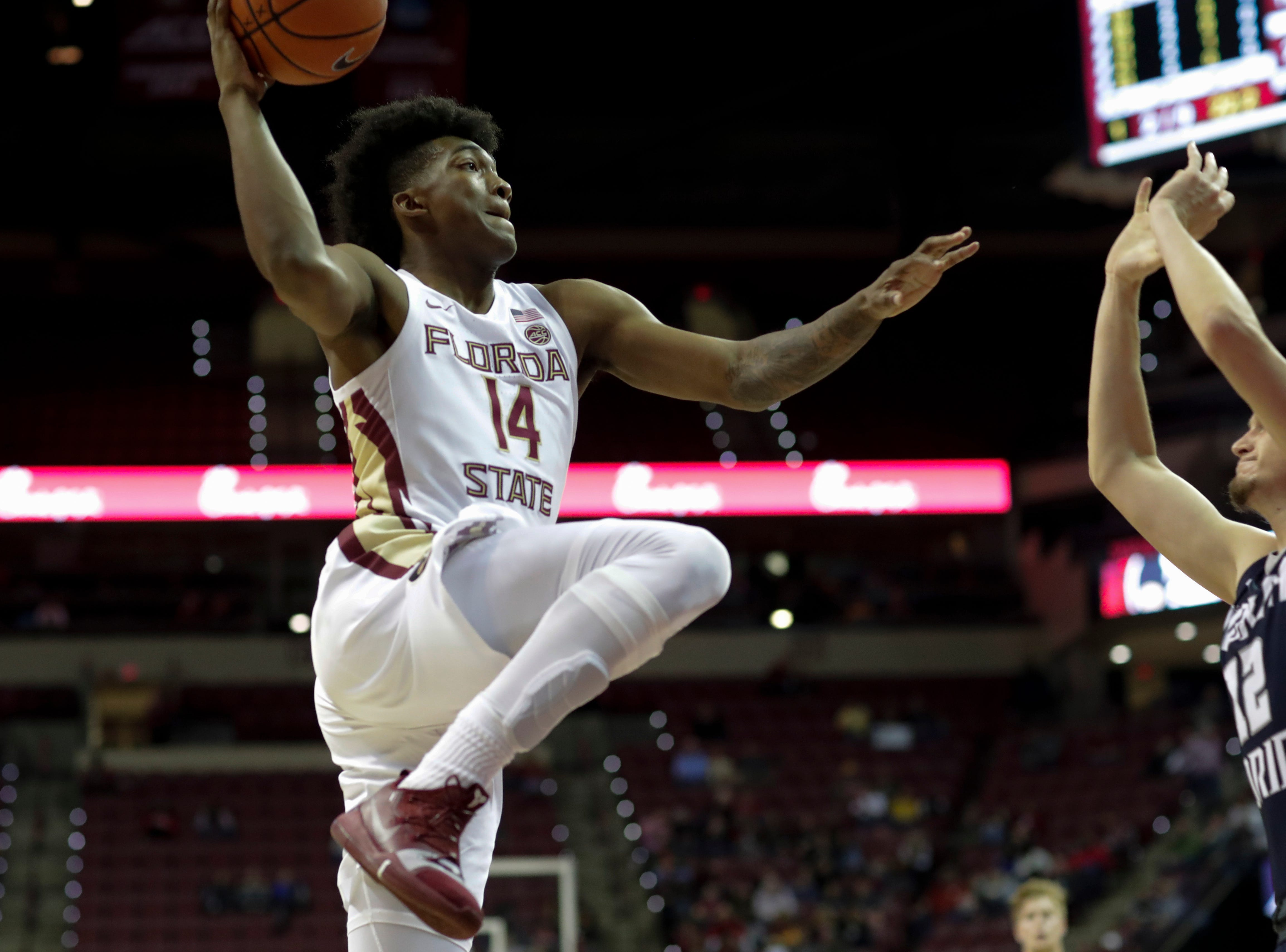 Florida State Seminoles guard Terance Mann (14) drives to the hoop during a game between Florida State University and the University of North Florida at Donald L. Tucker Civic Center in Tallahassee, Fla. Wednesday, Dec. 19, 2018.
