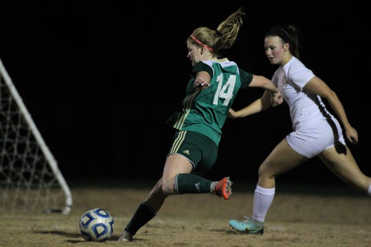 Lincoln senior McIver Levy takes a left-footed shot, but Leon beat Lincoln 2-1 on Monday, Dec. 17, 2018.