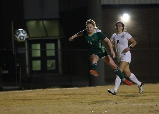 Lincoln senior McIver Levy fires a shot on goal during a game against Leon this past week. Levy scored, but the Trojans lost 2-1.