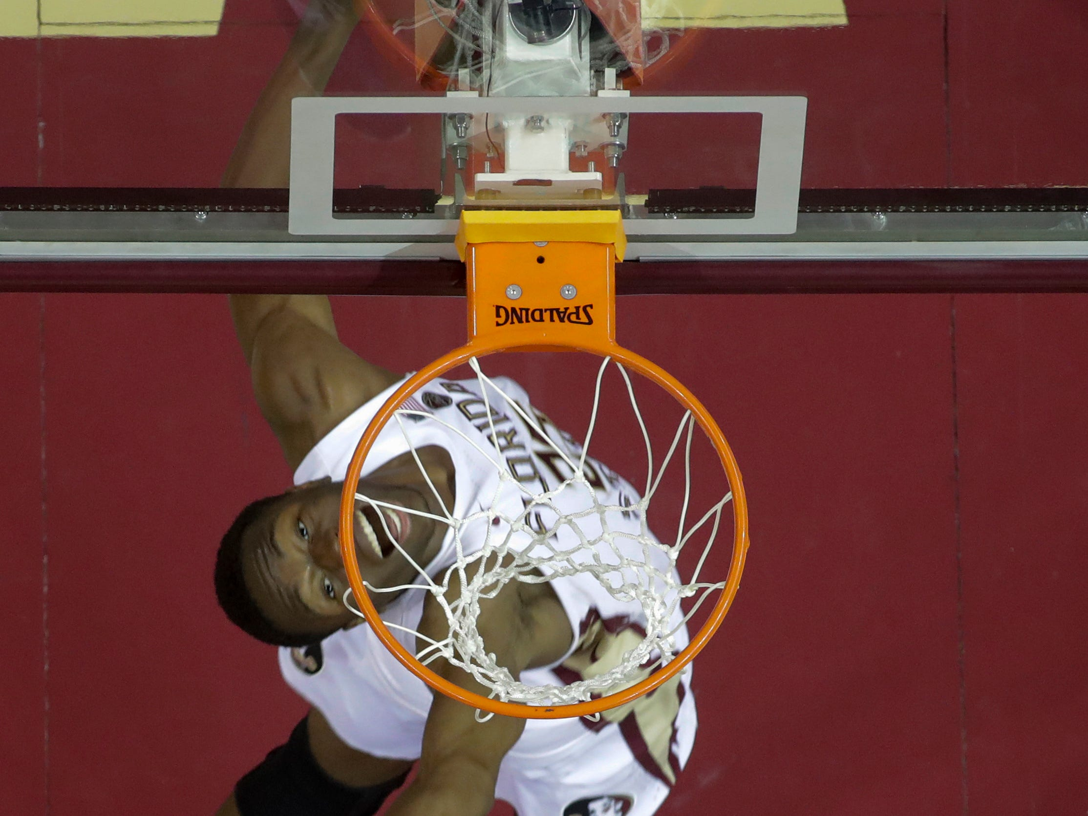Florida State Seminoles forward Mfiondu Kabengele (25) reaches for the ball under the hoop during a game between Florida State University and the University of North Florida at Donald L. Tucker Civic Center in Tallahassee, Fla. Wednesday, Dec. 19, 2018.
