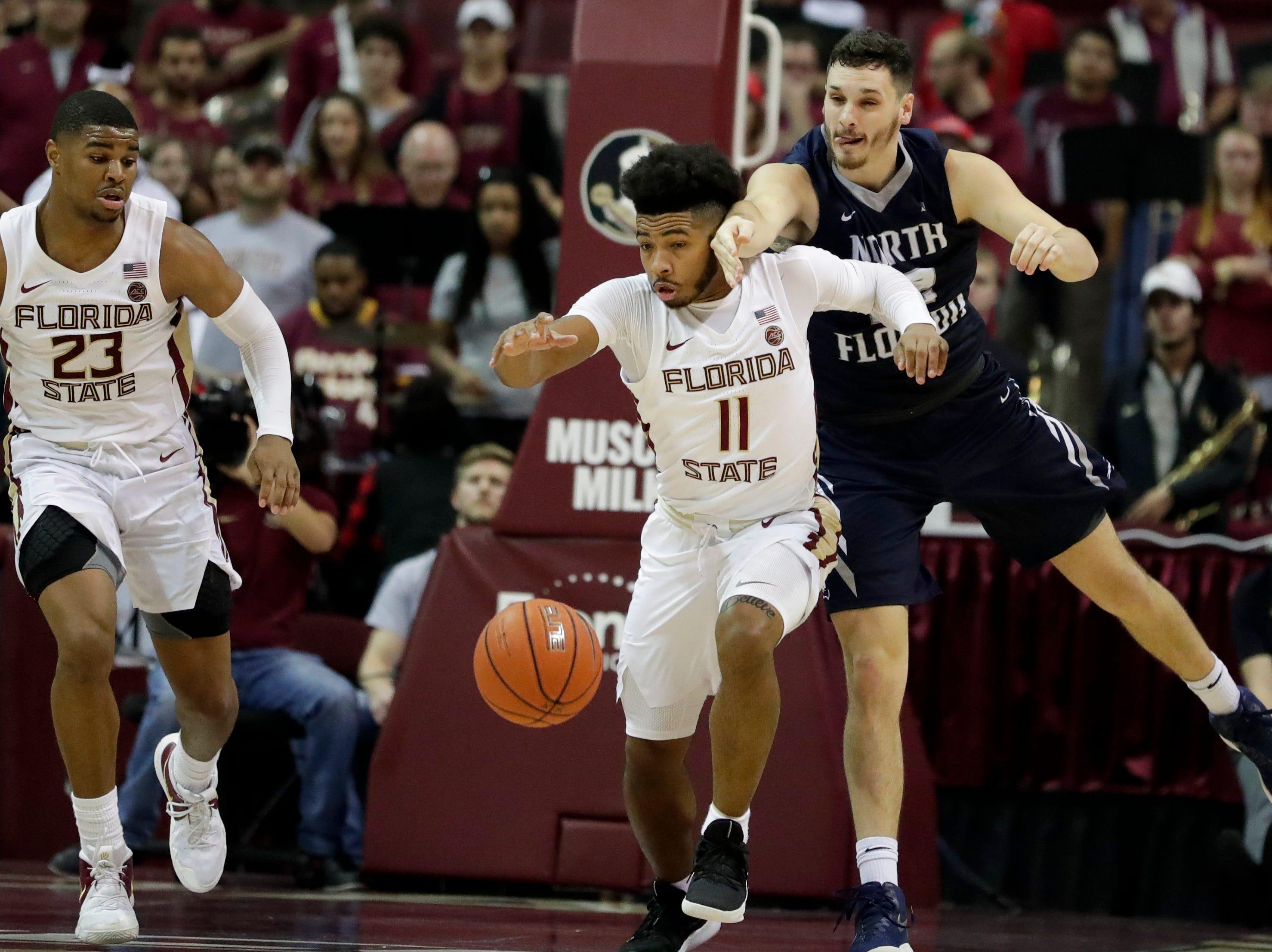 Florida State Seminoles guard David Nichols (11) reaches for a loose ball during a game between Florida State University and the University of North Florida at Donald L. Tucker Civic Center in Tallahassee, Fla. Wednesday, Dec. 19, 2018.