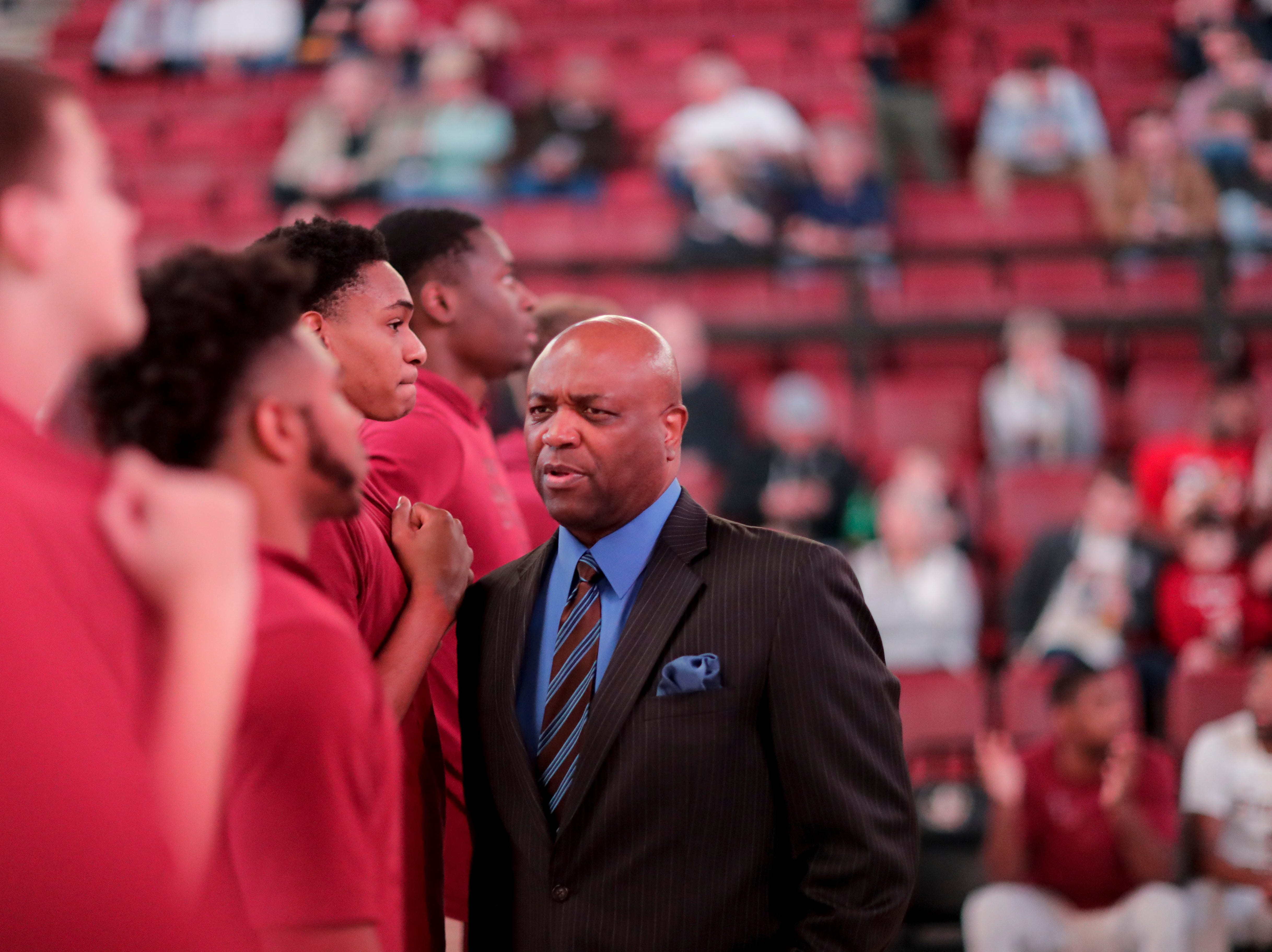 Florida State Seminoles head coach Leonard Hamilton talks to his players before the starters are announced during a game between Florida State University and the University of North Florida at Donald L. Tucker Civic Center in Tallahassee, Fla. Wednesday, Dec. 19, 2018.