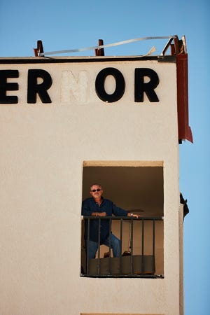 Wylie Petty, general manager of the El Governor Motel in Mexico Beach, stands in its window after Hurricane Michael.