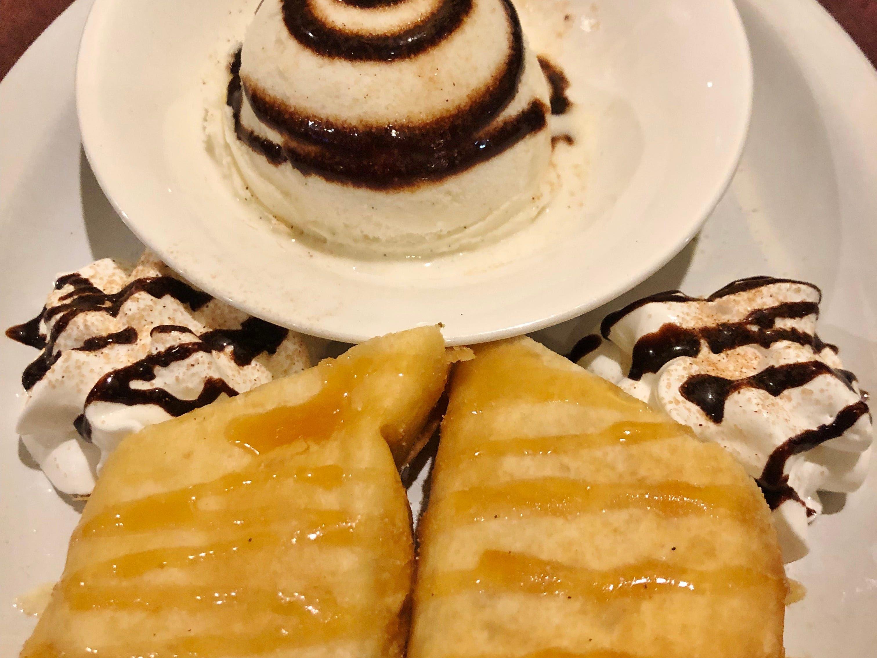 Casa Azteca's cheesecake chimichanga was a sweet, deep fried tortilla shell stuffed with creamy cheesecake filling and drizzled with caramel sauce and two dollops of whipped cream. On the side was a scoop of vanilla ice cream with a swirl of chocolate sauce.