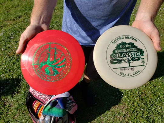 In Roger Jacobsen's quiver of discs, he has custom designed ones commemorating tournaments he has competed in as a member of Treasure Coast Disc Golf.