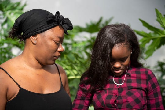 """She's going to have to deal with this for the rest of her life,"" said Christina Harris (left), mother of car crash survivor  Ari'yonnia Stanberry (right), 14, on Thursday, Dec. 20, 2018, during an interview at The Stuart News. ""That's hard seeing five people burn up in a car like that. She had to watch that, she experienced that,"" Harris said. ""She can tell me she's alright but I know she's not alright. She's never going to be alright."""