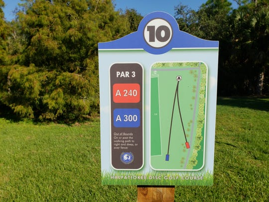 """Range signs at Halpatiokee Park in Stuart give disc golf players information about distance from tee box to """"hole."""""""