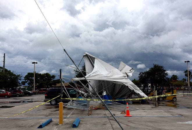 Gusts knocked down a tent at Home Depot in Stuart on Thursday as storms moved through the area.