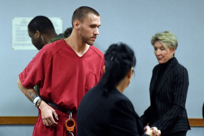 Tyler Hadley walks into Courtroom 2B on Thursday, Dec. 20, 2018 for a sentencing hearing at the St. Lucie County Courthouse in Fort Pierce. County Circuit Judge Gary Sweet ordered Hadley to serve two life prison terms at the same time for the 2011 murder of his parents Blake and Mary Jo Hadley. The sentence includes an automatic review after 25 years.