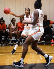 Lincoln Park Academy's Leroyeisha Thomas (left) passes the ball to Deborah Reese during the third period of their game against Port St. Lucie during the high school girls basketball game Wednesday, Dec. 19, 2018, at Lincoln Park Academy in Fort Pierce.