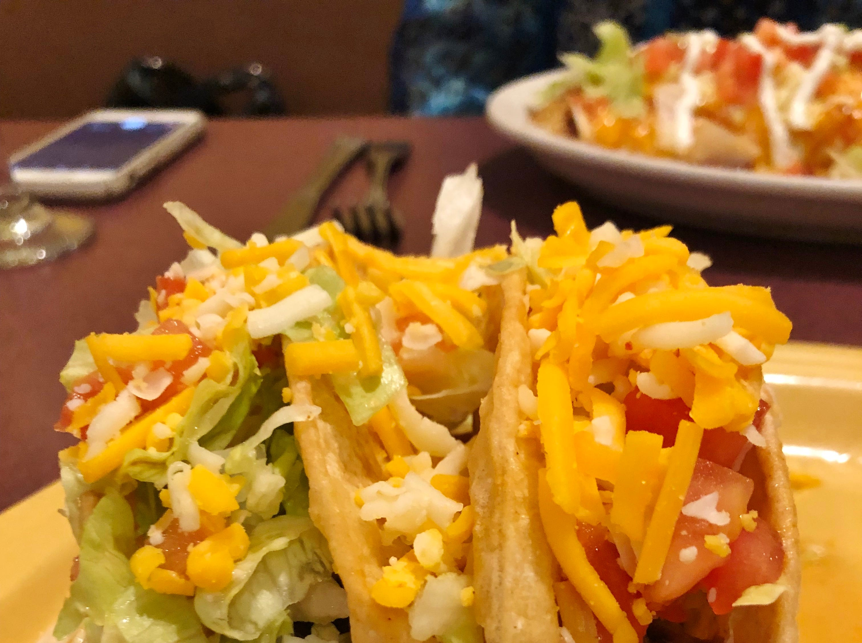 Casa Azteca's hard shell tacos with shredded beef served with lettuce, tomatoes and shredded cheese.